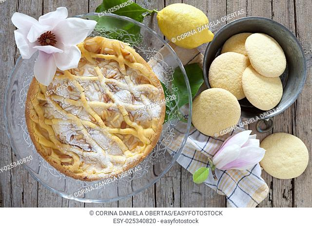 Italian pastry products: shortbread biscuits and grandma's cake, a tuscan cake with shortbread pastry, ricotta cheese and pine nuts