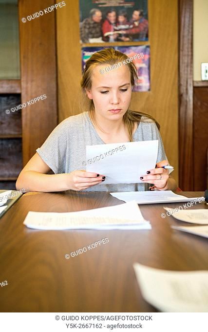 Harrison, New York, USA. Female secondary or high school student attending her lessons at the school for Dutch Language & Culture