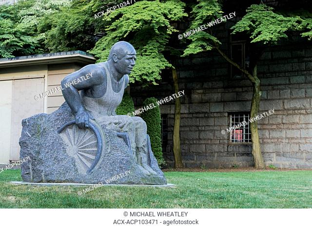 Granite sculpture of wheelchair athlete Rick Hansen, by artist William Koochin, Vancouver General Hospital grounds, Vancouver, British Columbia, Canada