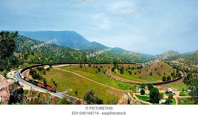 A frieght train heading east from Bakersfield passes Keene and comes to the Tehachapi Loop. The Loop is to correct a survey error of 70 feet and allow Los...
