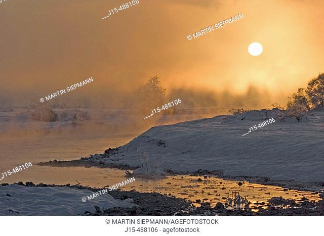 Winter morning at Isar river. Upper Bavaria, Germany