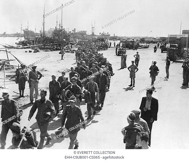 German prisoners, were captured on seacoast town in Italy, on their way to a POW stockade. Photo was made when Navy Secretary Frank Knox was touring the Italian...
