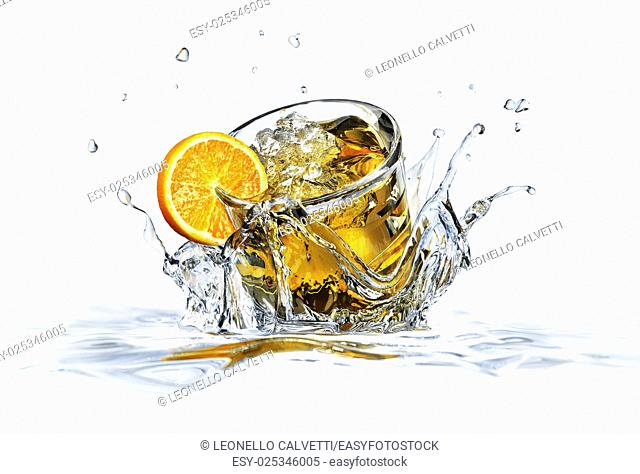 Cocktail glass, falling into clear water, forming a crown splash. On white background, with depth of field