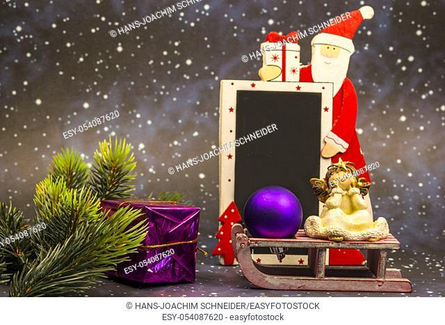 Santa Claus with empty blackboard