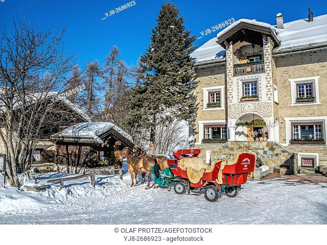 Sleigh in front of the Hotel Sonne at the Fex Valley in Winter, Engadine, Grisons, Switzerland