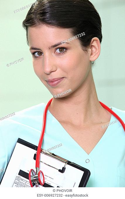 A medical professional with a clipboard and stethoscope