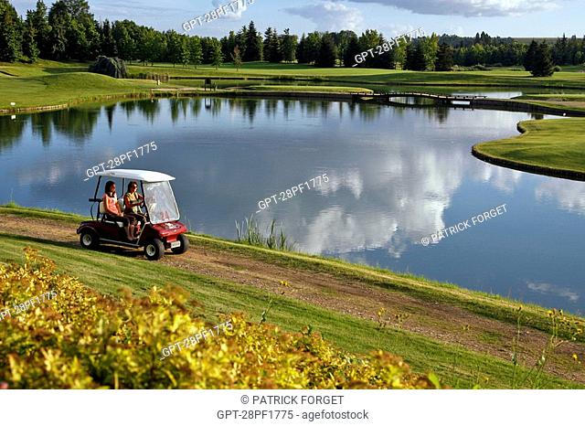 THE NANTILLY GOLF COURSE STRETCHES OUT AROUND PONDS DOMINATED BY TREE-COVERED HILLS, EURE-ET-LOIR 28, FRANCE