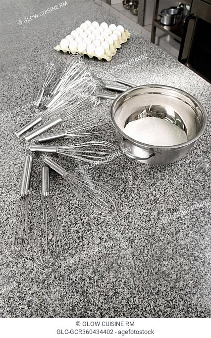 Bowl with wire whisks in a commercial kitchen