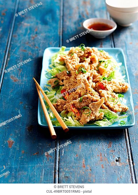 Fried sliced pork on salad