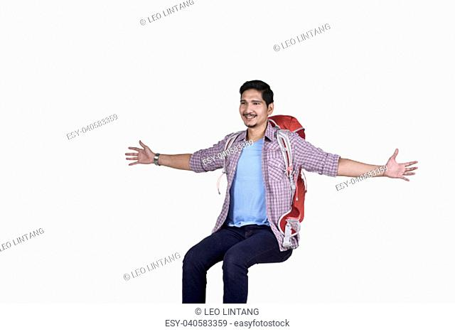 Images of asian traveler man enjoying with open hand isolated over white background