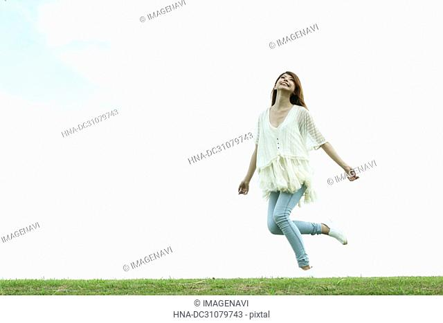 Young woman on a green field