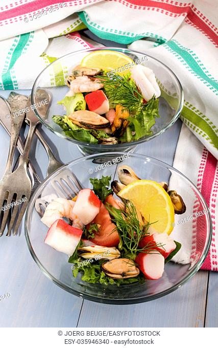 fresh seafood salad served in a glass bowl