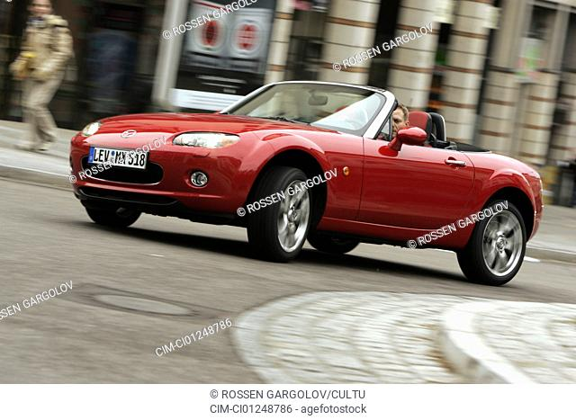 Mazda MX-5, model year 2005-, red, driving, diagonal from the front, frontal view, City, open top