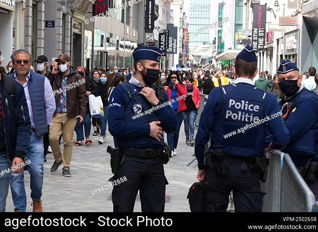 Illustration picture shows police at the Nieuwstraat/ Rue Neuve shopping street in Brussels, Saturday 16 May 2020. Belgium is in its ninth week of confinement...