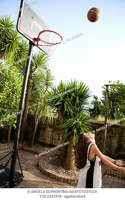 Girl Playing Basketball in the Garden