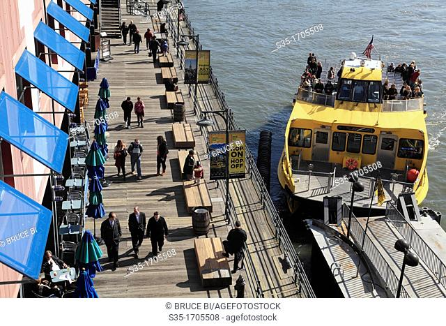 A East River water taxi arriving the stop of Pier 17 at South Street Seaport  New York City  New York  USA