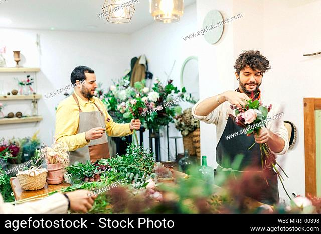 Men working while standing at flower shop