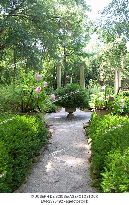 Path way in a formal garden with boxwoods.Georgia USA