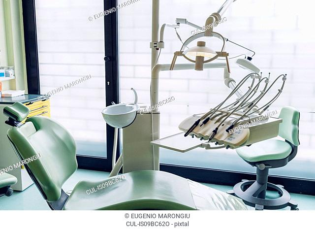 Dentist chair and equipment in dentist office