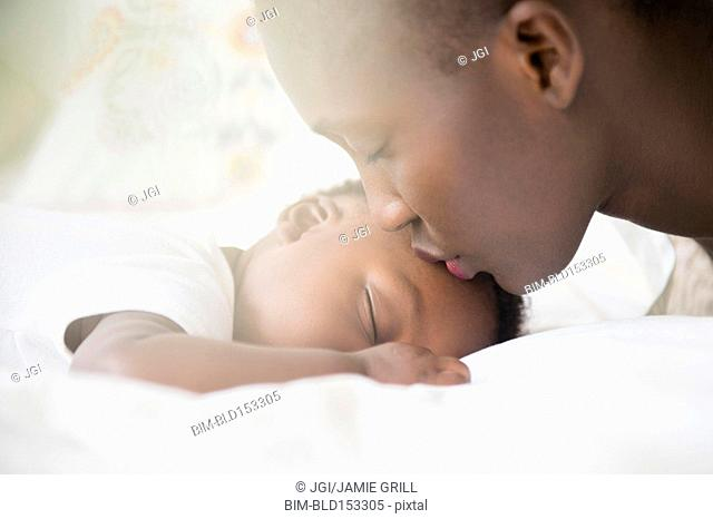Close up of Black mother kissing forehead of baby boy