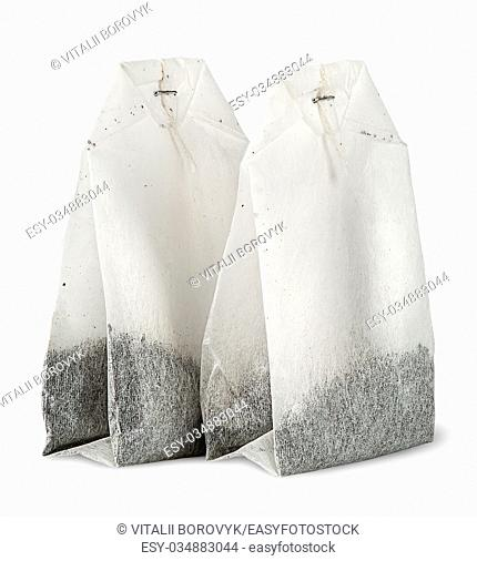 Two tea bags each other isolated on white background