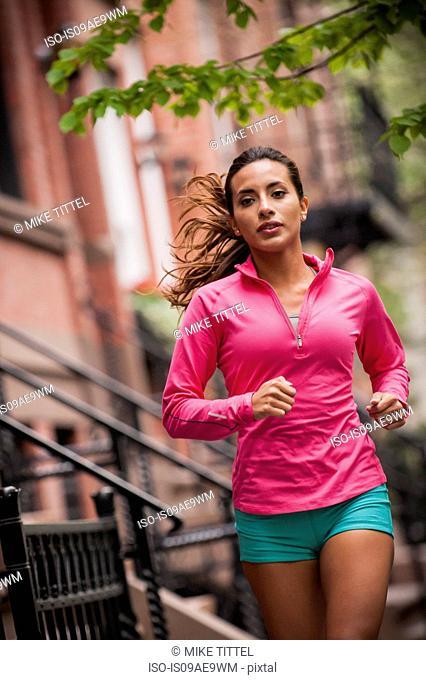 Woman jogging on sidewalk
