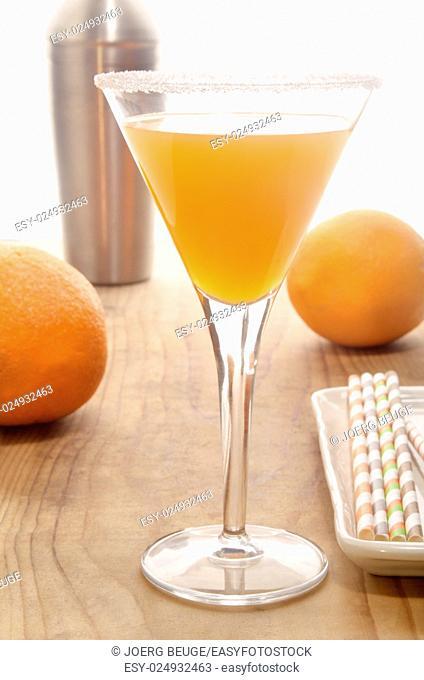 orange vodka in a cocktail glass with sugared rim