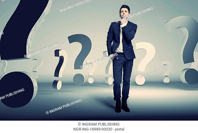 Handsome young businessman about questions