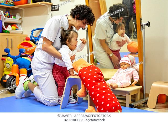 Physiotherapist teaching a girl with Down syndrome to stand up,Rehabilitation, Amara Berri Health Center building, Donostia, San Sebastian, Gipuzkoa