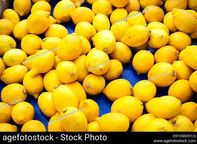 Lemons Citrus fruits on a market as texture or background