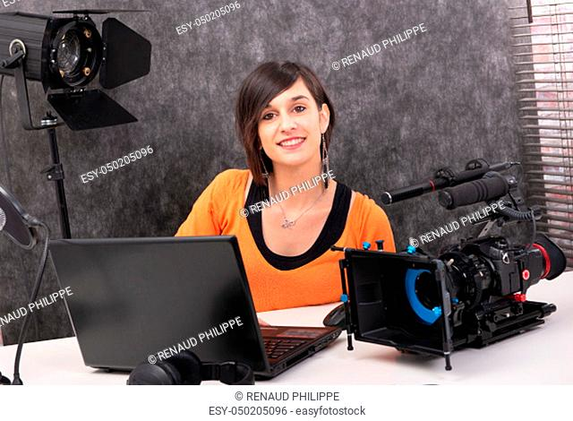 pretty young woman video editor working in studio