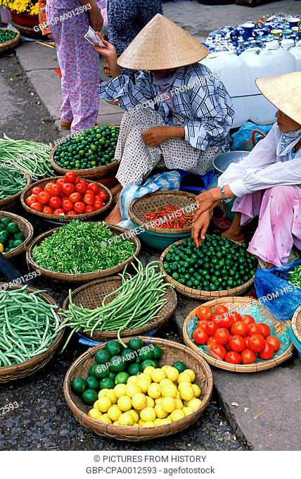 Vietnam: Fruit and vegetable vendors in a Vietnamese market