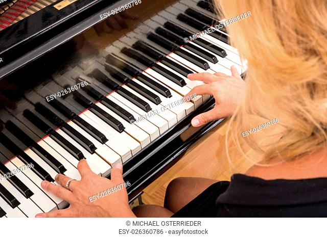 A classical musician playing piano.