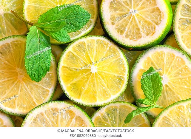 Fresh Lemon slices background and mint leaves