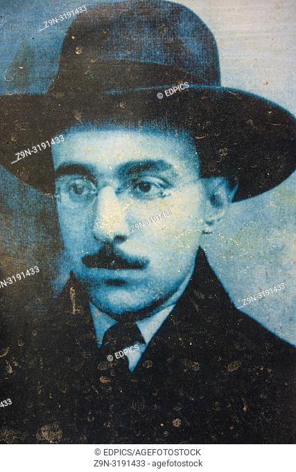 faded old picture postcard showing portuguese poet fernado pessoa, ferragudo, algarve, portugal