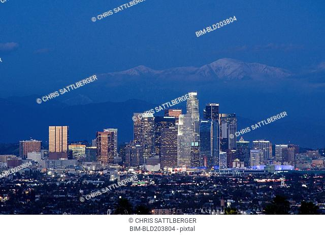 City skyline lit up at night, Los Angeles, California, United States