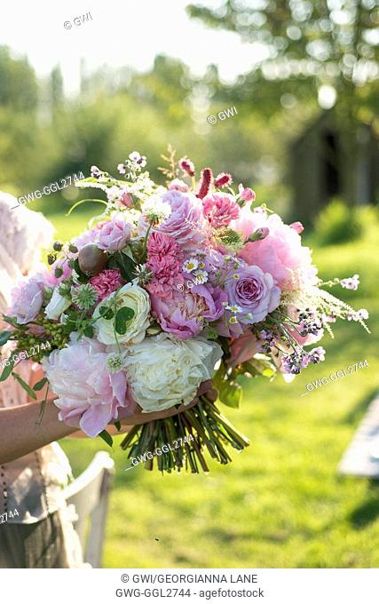 PAEONIA LACTIFLORA BOWL OF BEAUTY WITH ROSES CARNATIONS SCABIOSA AND SEED HEADS IN BOUQUET