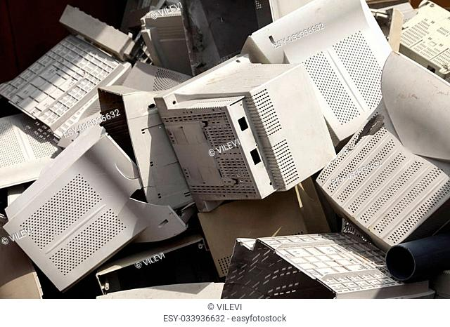 A pile of old broken monitor plastic shells ready for recycling