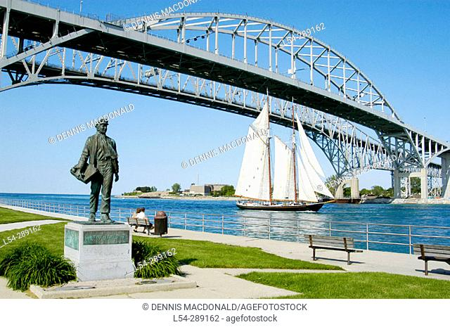 Tall ship Highlander passing under Blue Water International Bridge at Port Huron. Michigan. USA