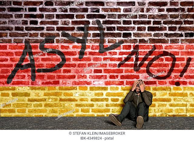 Asylum seeker sitting in front of a wall with writing no asylum and German flag, his head in his hands, Computer Graphic