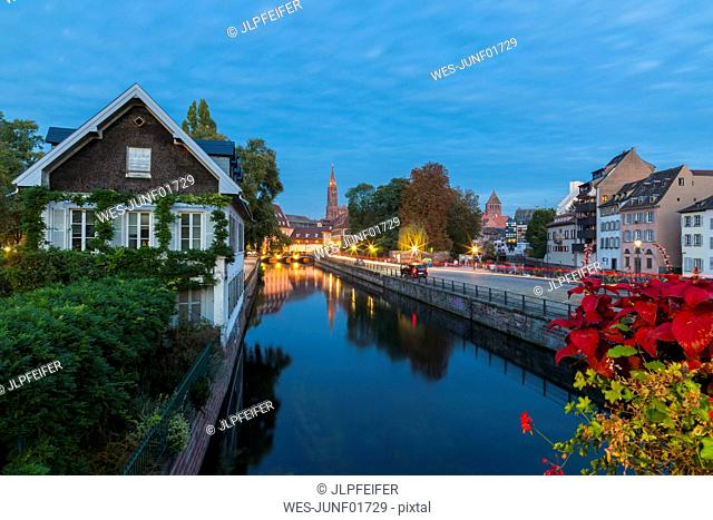 River ill along with buildings against sky at dusk, Strasbourg, France