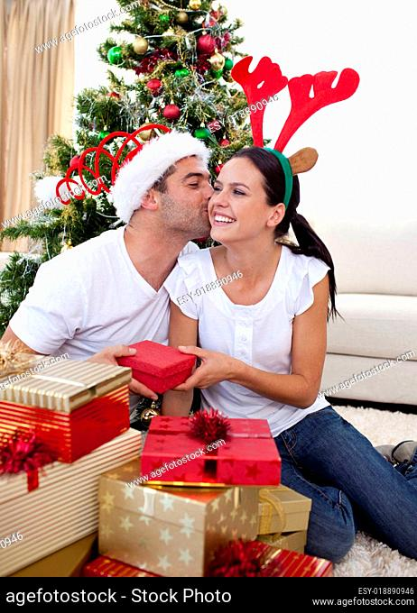 Lovely couple giving presents for Christmas