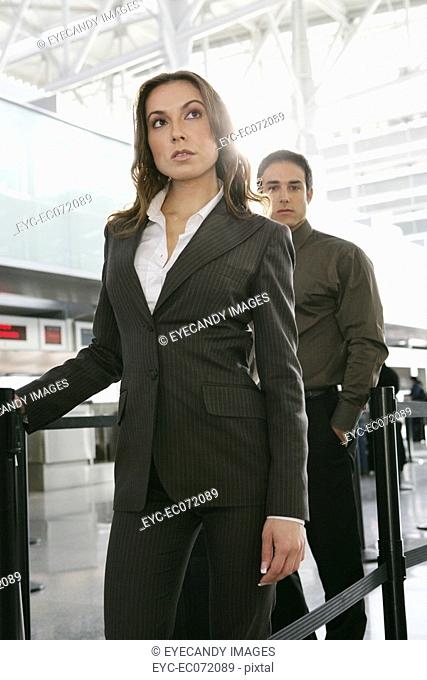 Businesspeople standing in airport