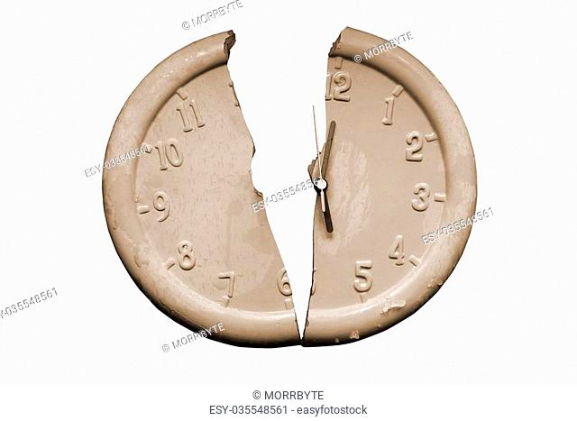 a broken clock face against a white background with a clipping path in sepia