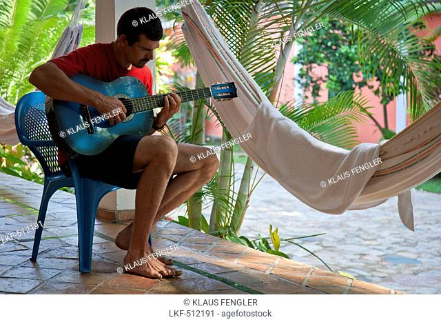 Man playing the guitar, Puerto Columbia, Henri Pittier National Park, Venezuela