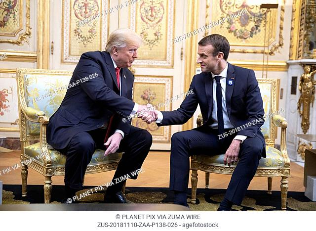 November 10, 2018 - Paris, France - U.S President Donald Trump, left, and French President Emmanuel Macron shake hands before the start of a during a bilateral...