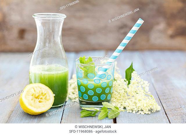 Vegan cucumber lemonade with mint and elderflower syrup