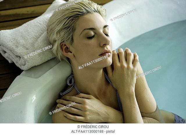 Woman soaking in tub