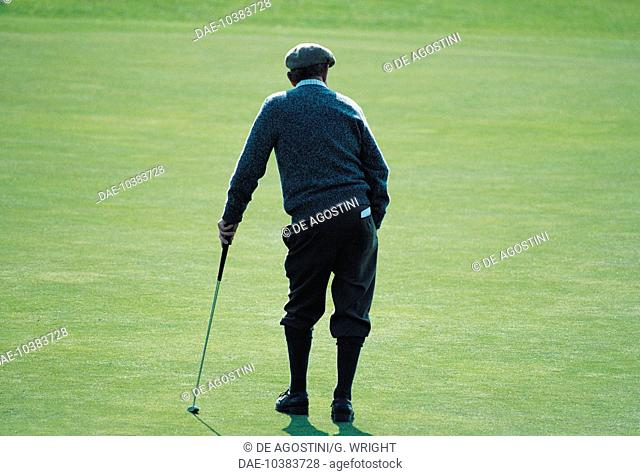 A golfer wearing traditional clothes, Royal and Ancient Golf Club of St Andrews, St Andrews, Scotland, United Kingdom