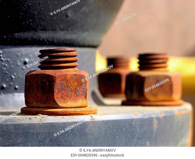 Old rusty metal nut on iron water valve